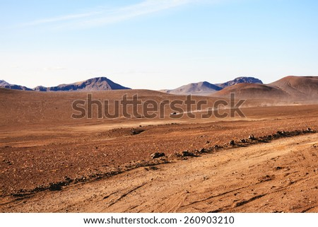 Landscape of desert with jeep - stock photo
