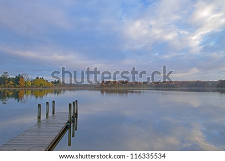 Landscape of dock and autumn shoreline of Whitford Lake, Fort Custer State Park, Michigan, USA