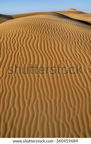 Landscape of dunes orange background.Huge dunes of the desert.Sand dunes of Dubai.Structure in the desert sand. - stock photo