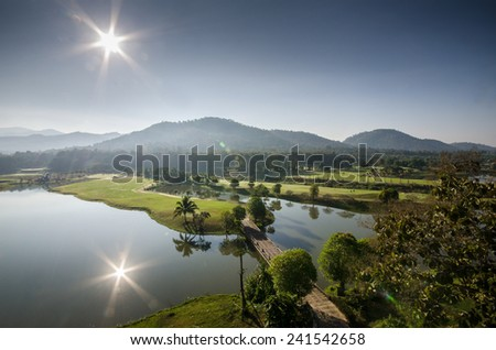 Landscape of green golf course ,sunset on golf field - stock photo