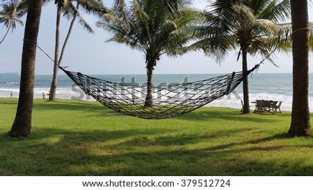 landscape of Hammock and the sea with coconut tree for relaxing
