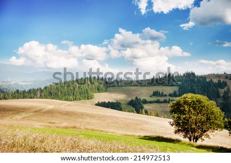 Landscape of hills and mountains at the sunny day