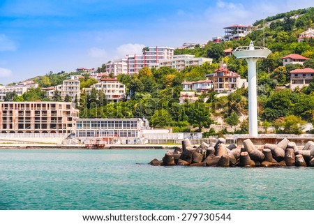 Landscape of Kavarna, coastal town and seaside resort in northeastern Bulgaria, Black Sea coast. Entrance to the port with lighthouse tower - stock photo