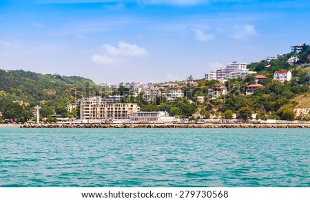 Landscape of Kavarna, coastal town and seaside resort in northeastern Bulgaria, Black Sea coast. Entrance to the port with lighthouse - stock photo