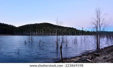 Landscape of lake Advancetown at dusk in Gold Coast Queensland, Australia.. - stock photo
