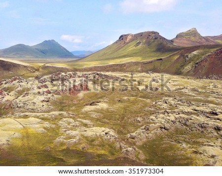 Landscape of Landmannalaugar area in Iceland There are mountains and volcanos covered with moss during a sunny day