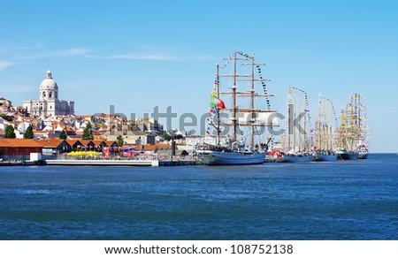 Landscape of Lisbon and sailboats - stock photo