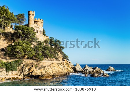 Landscape of Lloret de Mar Castle and its beach in a sunny afternoon.
