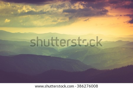 Landscape of misty mountain hills in spring. Filtered image:cross processed vintage effect. - stock photo