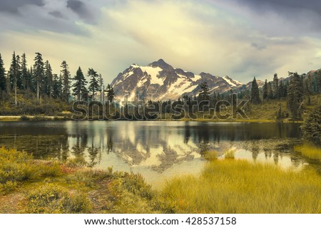 Landscape of Mt. Shuksan. Washington State. Washington is a state in the Pacific Northwest. The Washington state's largest city is Seattle. This is one of the landmarks of Washington State - stock photo