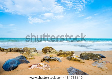 landscape of ocean with waves clouds and rocks on beach, pattaya thailand
