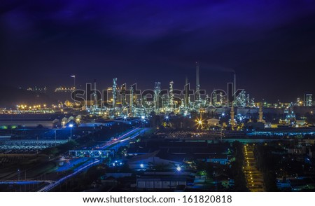 Landscape of oil refinery industry with oil storage tank and port - stock photo