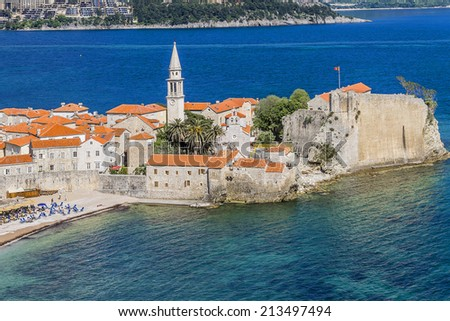 Landscape of old town Budva: Ancient walls and tiled roof of old town Budva, Montenegro, Europe. Budva - one of the best preserved medieval cities in the Mediterranean.