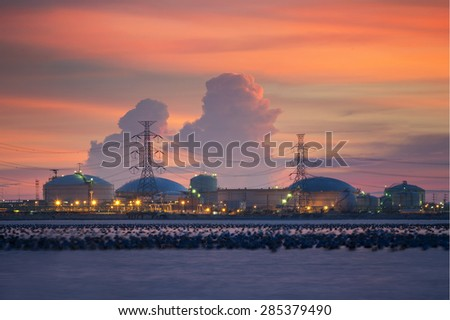 Landscape of Petrochemical industry on sunset colorful sky - stock photo