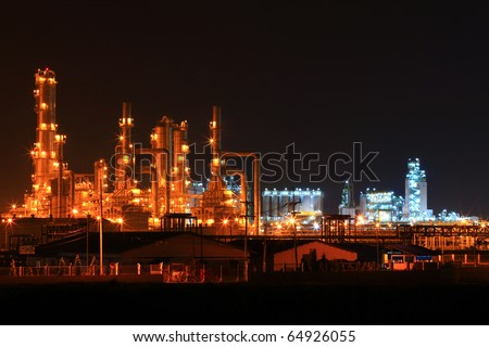 landscape of  petrochemical oil refinery plant at night - stock photo