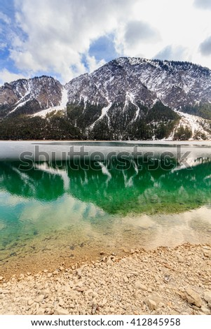 Landscape of Plansee lake and Alps mountains in winter, evening view, Tyrol, Austria. - stock photo