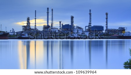 Landscape of river and oil refinery factory between sun rise time in Chao praya river, Bangkok, Thailand.