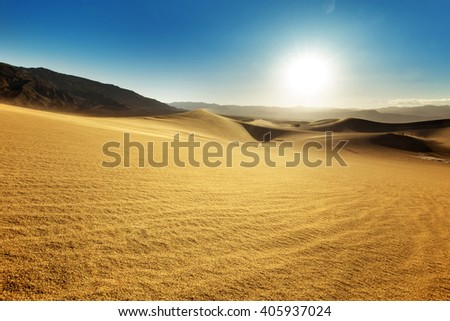 landscape of sand dunes in a sunny sky - stock photo