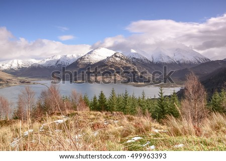 Landscape of Scotland - snow on mountains, ocean - beautiful scenery