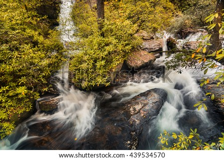 Landscape of series of waterfalls in Georgia, Tennesse state line, United States(USA). This waterfalls is part of the Smokey Mountains National Park. This landscape was taken in falls foliage season - stock photo