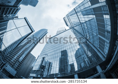 landscape of silhouettes of skyscrapers in the city. toning image. Focus on the tops of skyscrapers  - stock photo