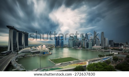 Landscape of Singapore city in day morning time with strom. - stock photo