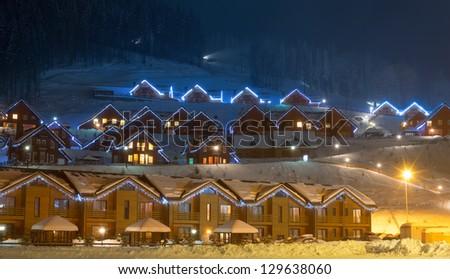 Landscape of ski village at night - stock photo