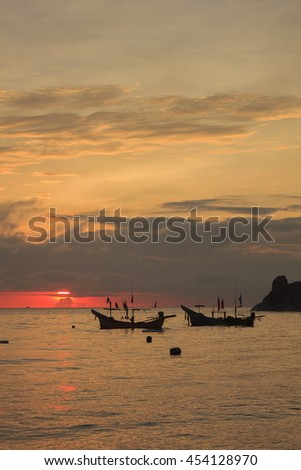 Landscape of sky and sea which has small fishing boat at dawn ; southern of Thailand