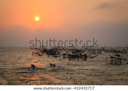 landscape of square dip net at sunrise time from phattalung prefecture , thailand