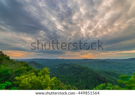 Landscape of sunrise over mountains with blue sky and clouds - stock photo