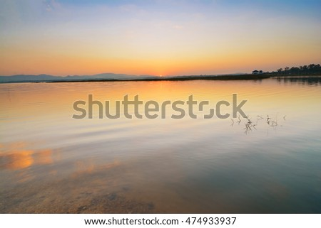 Landscape of sunrise reflective on the water at reservoir