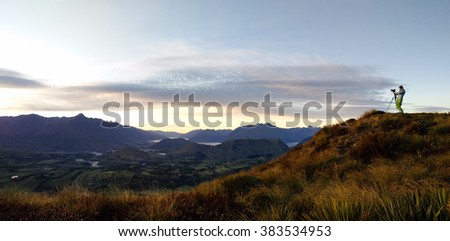 Landscape of Sunrise view from Coronet Peak-look out view with the colors sky and lake-golden grass on the hill, Queens town, New Zea-land