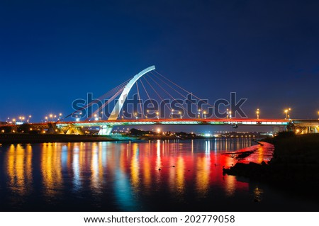 landscape of Taipei with bridge at night - stock photo