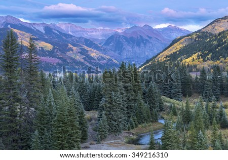 Landscape of Telluride with golden, green and red aspen in Colorado