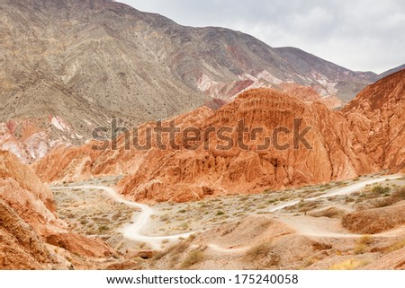 Landscape of the amazing colorful red rocks in the argentinian desert near Salta, in Purmamarca - stock photo