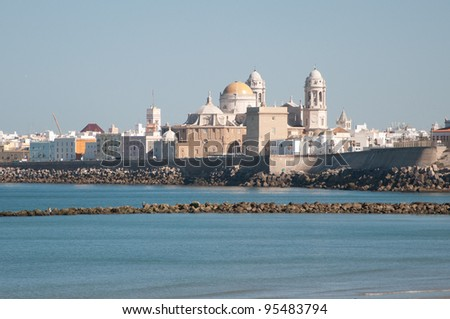 Landscape of the Cathedral of Cadiz from the beach - stock photo