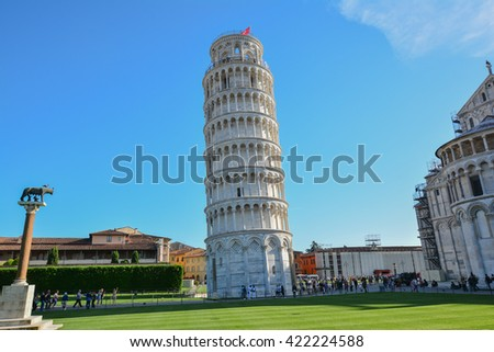 landscape of the city of Pisa with the cathedral and the leaning tower of white marble in Tuscany Italy - stock photo
