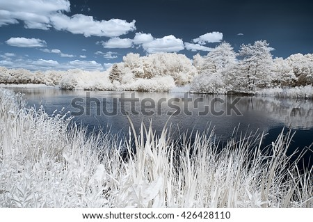 Landscape of the english countryside in infrared looking like frost and snow - stock photo