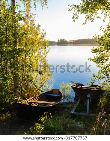 Landscape of the lake with a boat in the foreground. Vertical frame. Haukivesi lake. Finland.