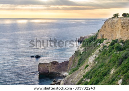 Landscape of the rocky seashore at sunset