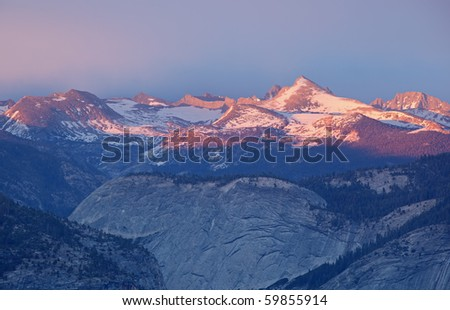 Landscape of the Sierra Nevada Mountains at twilight from Glacier Point, Yosemite National Park, California, USA - stock photo