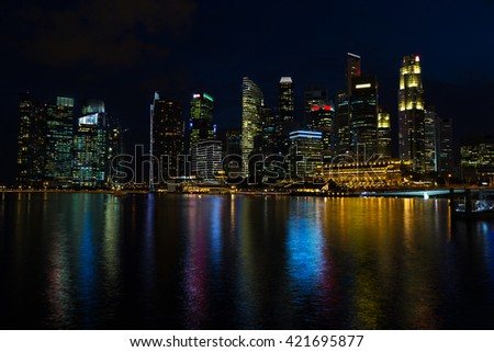 Landscape of the Singapore financial district and business buildings in lights at night outdoors