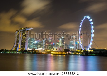 Landscape of the Singapore landmark financial district at night scene with black sky and clouds