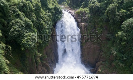 Landscape of Very high Waterfall from cliff in forest, Thailand.