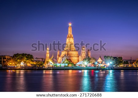 Landscape of Wat Arun at twilight time. A Buddhist temple located along the Chao Phraya river in Bangkok , Thailand  - stock photo
