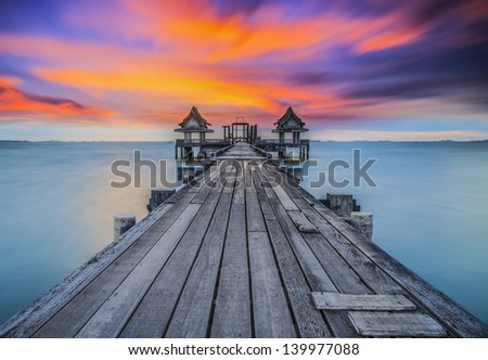 Landscape of Wooded bridge in the port between sunrise - stock photo