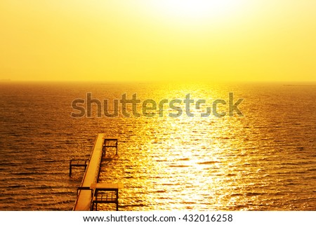 Landscape of Wooded bridge pier between sunset. Living is Path filled with Love. - stock photo
