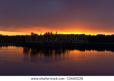 Landscape on wood lake after a sunset - stock photo