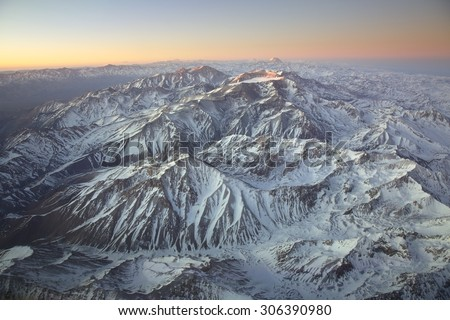Landscape overflying the Andes range and the Aconcagua mountain - stock photo