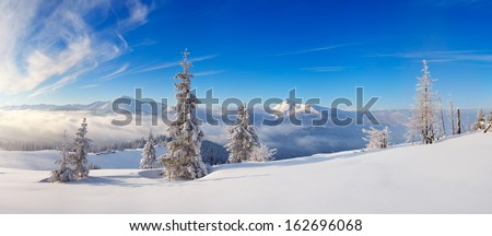 Landscape panorama of a frosty day in the mountains. Ukraine, Carpathian mountains, view of the mountain range Chornohora - stock photo